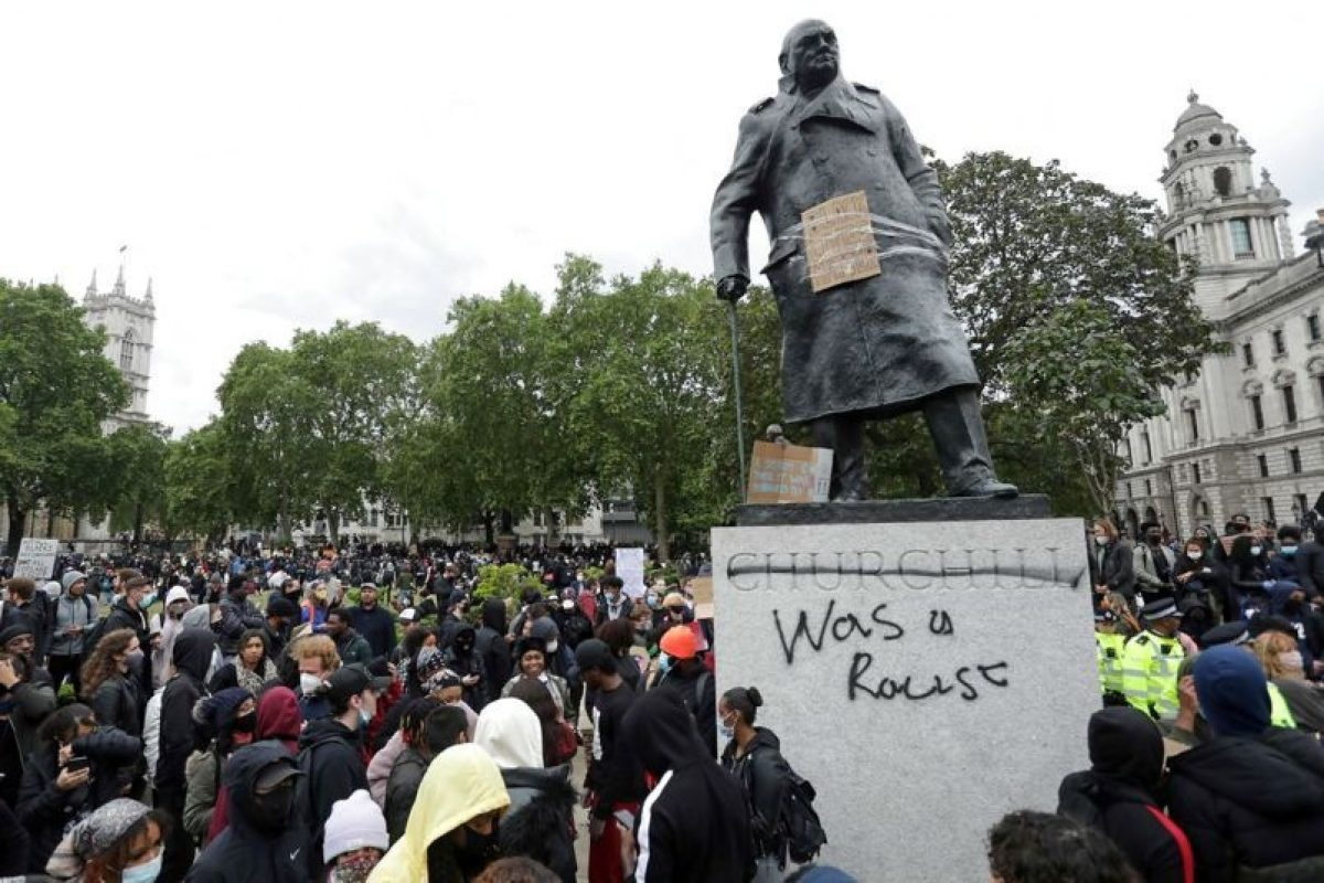 The statue of former British prime minister Winston Churchill is seen defaced, with the words (Churchill)